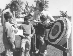 DeSales: Frank DeMilde & Dave Whalen  on archery range with campers